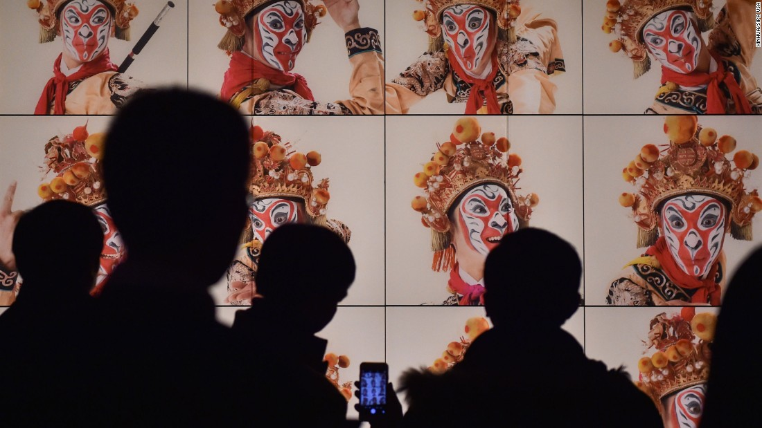 Visitors view pictures at the Capital Museum in Beijing on Monday, February 1. Nearly 60 pieces of art featuring monkey figures were on display.