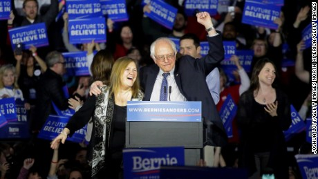 DES MOINES, IA - FEBRUARY 1 : Democratic presidential candidate Bernie Sanders stands on stage with his wife Jane OÕMeara Sanders during his Caucus night event at the at the Holiday Inn February 1, 2016 in Des Moines, Iowa. Sanders was in a virtual tie with Secretary of State Hillary Clinton late in caucus polling. (Photo by Joshua Lott/Getty Images)