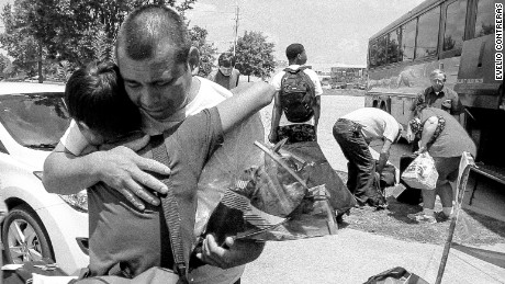 Jesús embraces his father, Pedro, for the first time in 13 years on July 22, 2014. Pedro left his family in Guatemala when Jesus was 1-year-old to find employment in the United States.