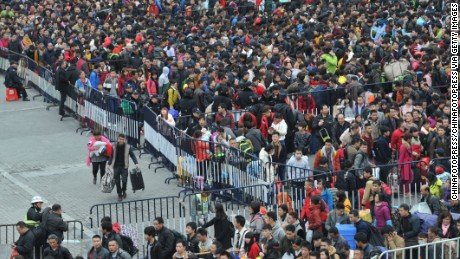 About 50,000 passengers wait for their trains at Guangzhou Railway Station after heavy snow delayed numerous trains on February 2, 2016 in Guangzhou, Guangdong Province of China. Chinese people are preparing for the Spring Festival, the Year of Monkey, which will fall on February 8 according to Chinese calendar.
