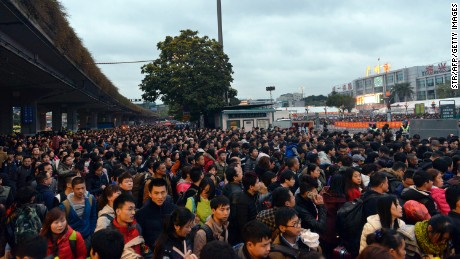 This picture taken on February 1, 2016 shows huge queues outside Guangzhou railway station in Guangzhou, in southern China's Guangdong province.  Tens of thousands of Lunar New Year travelers in China were stranded on February 2 at a station in Guangzhou, state media said, after snow and ice elsewhere disrupted the world's largest annual human migration.