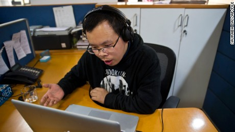 FILE - In this Nov. 20, 2015 file photo, Chinese journalist Li Xin talks to an Associated Press reporter over Skype, at the Associated Press office in New Delhi, India. A Chinese journalist who disappeared while seeking asylum abroad turned up Wednesday, Feb. 3, 2016 telling his wife by phone he voluntarily returned to China for an investigation, in the latest case of Beijings increasingly strong reach beyond its borders for wanted people. (AP Photo/Saurabh Das, File)