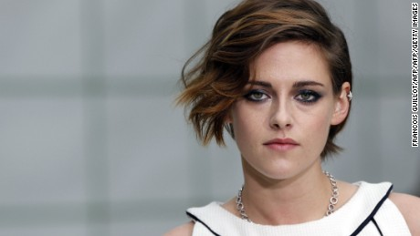 US actress Kristen Stewart poses prior to attend Chanel 2015 Haute Couture Spring-Summer collection fashion show on January 27, 2015 at the Grand Palais in Paris.  AFP PHOTO / FRANCOIS GUILLOT        (Photo credit should read FRANCOIS GUILLOT/AFP/Getty Images)