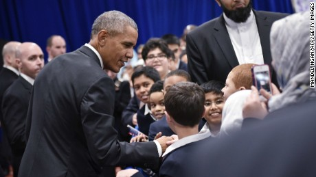 US President Barack Obama greets attendees in an overflow room after speaking at the Islamic Society of Baltimore, in Windsor Mill, Maryland,on February 3, 2016.