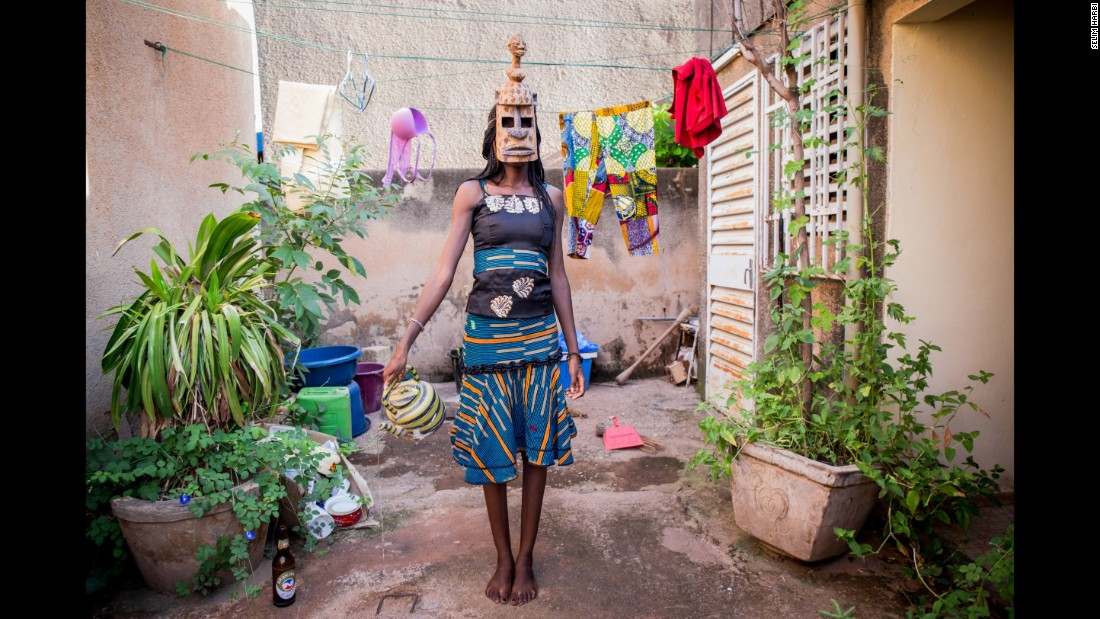 Judith, 22, wears a mask of fertility from the Dogon ethnic group. She's a student in Ivory Coast who dreams of a career as a model, Harbi said.