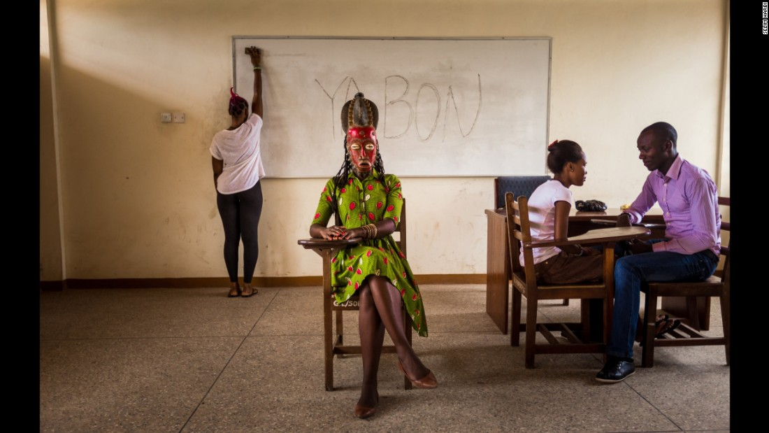 Jaqueline, 32, wears the Baoule mask of a queen. She teaches Portuguese in Accra.