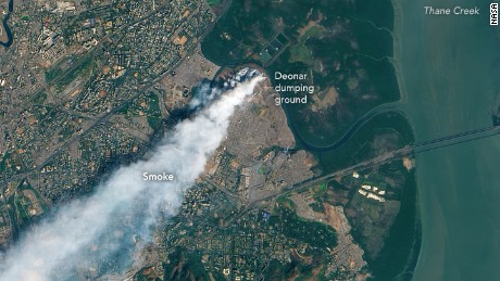 A NASA image shows the extent of a smoke plume from a huge blaze at the Deonar garbage dump in Mumbai.