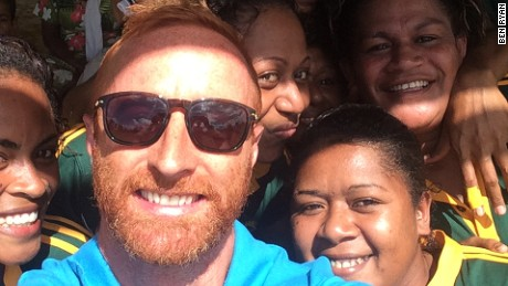 Ben Ryan takes a selfie with Fijian locals