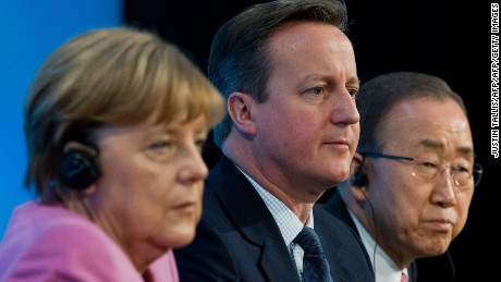German Chancellor Angela Merkel (L) British Prime Minister David Cameron (C) and UN Secretary-General Ban Ki-moon sit on stage  during a press conference at the QEII centre in central London on February 4, 2016, towards the end of a donors' conference entitled 'Supporting Syria & The Region'.  British Prime Minister David Cameron announced Thursday that a Syria donors' conference in London had raised over $10 billion (9.0 billion euros) for humanitarian aid. / AFP / JUSTIN TALLISJUSTIN TALLIS/AFP/Getty Images