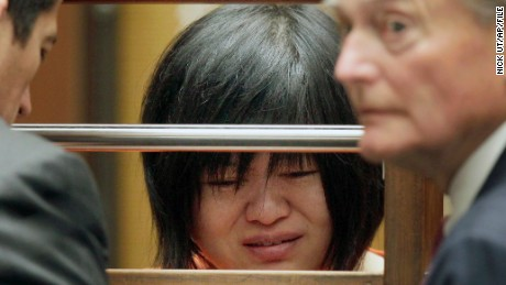 "Dr Hsiu Ying ""Lisa"" Tseng cries during her arraignment, flanked by attornies, Edward Welbourn, left, and Alan Stokke, Friday, March 16, 2012 in Los Angeles. Tseng, a California doctor, has pleaded not guilty to charges of second-degree murder in the prescription drug overdose deaths of three patients. (AP Photo/Nick Ut)"
