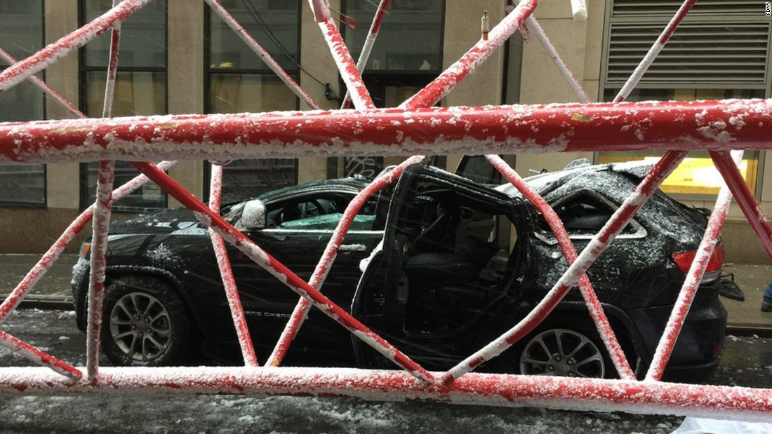 The crane collapsed on a Manhattan street Friday morning in snowy conditions.