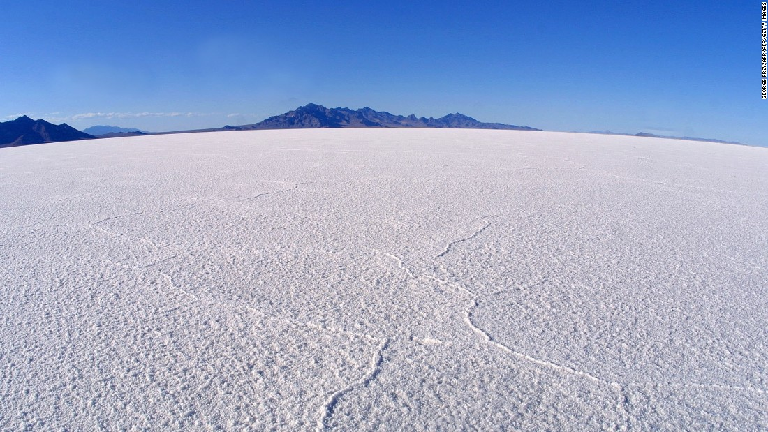 """""""You have no real distance reference,"""" says Biscaye of the challenge the salt flats offer. """"Just the markers on the side of the road indicating how many miles have past, and a mountain at the end."""""""