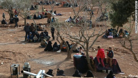 Syrians fleeing Aleppo wait in a field in the town of Iqda, Syria, on Friday, February 5.