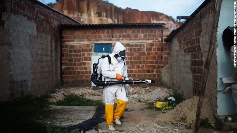 RECIFE, BRAZIL - FEBRUARY 04: A city worker fumigates in an effort to eradicate the mosquito which transmits the Zika virus on February 4, 2016 in Recife, Pernambuco state, Brazil. Officials say as many as 100,000 people may have already been exposed to the Zika virus in Recife, which is being called the epicenter of the crisis, although most never develop symptoms. Tourists are arriving in the city for its famed Carnival celebrations which begin tomorrow. (Photo by Mario Tama/Getty Images)