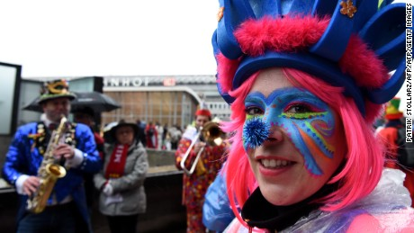 A woman in fancy dress and with her face painted celebrates at Cologne's carnival, on February 4, 2016.