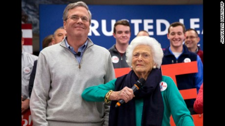 Barbara Bush, right, jokes with her son, Republican presidential candidate, former Florida Gov. Jeb Bush, while introducing him at a town hall meeting at West Running Brook Middle School in Derry, N.H., Thursday Feb. 4, 2016. (AP Photo/Jacquelyn Martin)