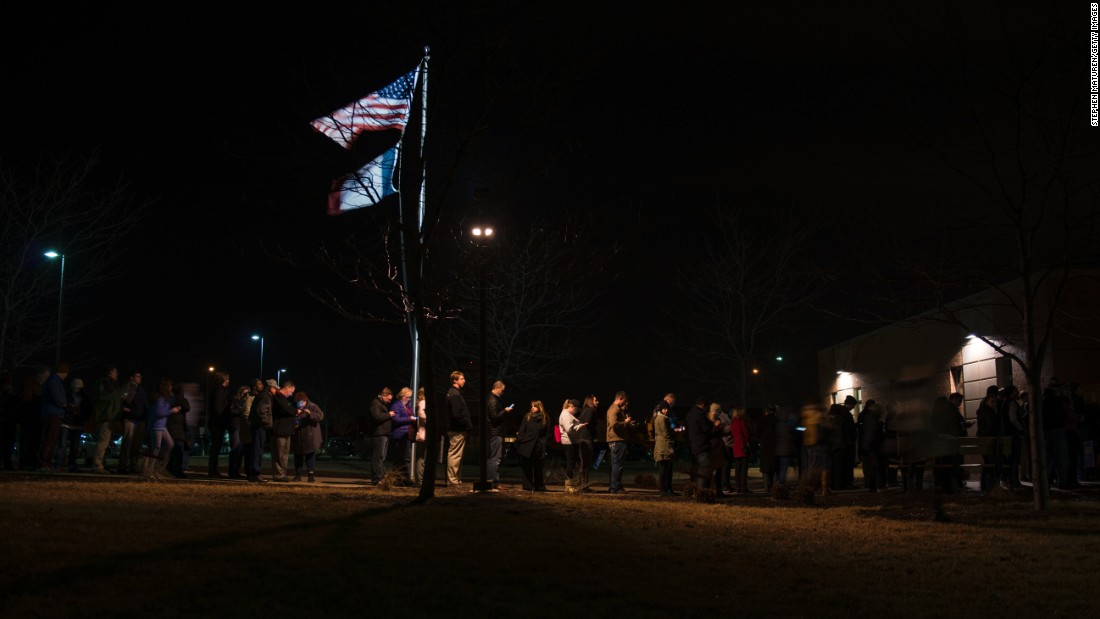 """<a href=""""http://www.cnn.com/2016/02/01/politics/gallery/iowa-caucuses/index.html"""" target=""""_blank"""">Iowa caucus</a>goers line up outside a Democratic meeting held at Maple Grove Elementary in West Des Moines on Monday, February 1. Former Secretary of State Hillary Clinton and Vermont Sen. Bernie Sanders were deadlocked at 50% after 99% of votes had been counted, but Clinton emerged victorious early the following morning."""