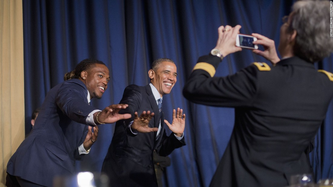 """University of Alabama football player and Heisman Trophy winner Derrick Henry and President Barack Obama strike a """"Heisman pose"""" during the <a href=""""http://www.cnn.com/2016/02/04/politics/obama-national-prayer-breakfast/"""" target=""""_blank"""">National Prayer Breakfast</a> in Washington on Thursday, February 4. The annual event brings together U.S. and international leaders and figures from different parties and religions for an hour devoted to faith."""