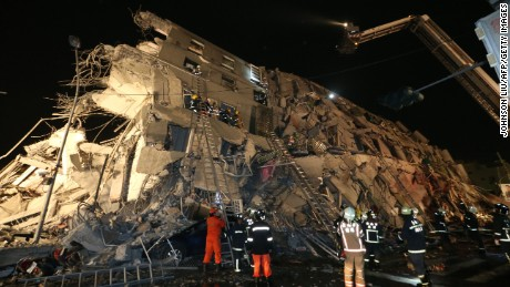 Rescue personnel carry a survivor at the site of a collapsed building in the southern Taiwanese city of Tainan following a strong 6.4-magnitude earthquake that struck the island early on February 6, 2016. At least 30 people have been rescued after four buildings collapsed after a shallow quake struck at a depth of 10 kilometres (six miles) around 2000 GMT Friday, according to the US Geological Survey, 39 kilometres northeast of Kaohsiung, the second-largest city on the island and an important port. / AFP / Johnson Liu        (Photo credit should read JOHNSON LIU/AFP/Getty Images)