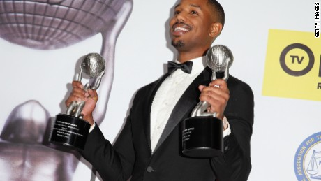 Caption:PASADENA, CA - FEBRUARY 05: Actor Michael B. Jordan poses with his Outstanding Actor in a Motion Picture award and Entertainer of the Year award in the press room during the 47th NAACP Image Awards presented by TV One at Pasadena Civic Auditorium on February 5, 2016 in Pasadena, California. (Photo by Imeh Akpanudosen/Getty Images for NAACP Image Awards)
