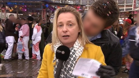 As Esmeralda Labye delivered her live report for RTBF, one man kissed her on the neck.