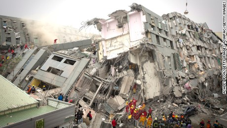 TAINAN, TAIWAN - FEBRUARY 06:  Rescue personnel search for survivors at the site of a collapsed building on February 6, 2016 in Tainan, Taiwan. A magnitude 6.4 earthquake hit southern Taiwan early Saturday, toppling several buildings and killing at least two people in Tainan, according to local news reports.  (Photo by Ashley Pon/Getty Images)