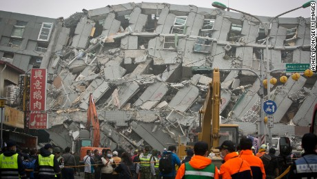 Rescue personnel search for survivors at the site of a collapsed building in Tainan, Taiwan, on Saturday, February 6.