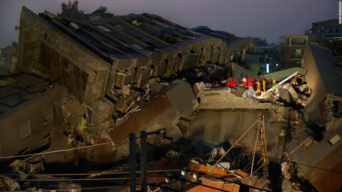 Rescue teams search the collapsed building in Tainan.