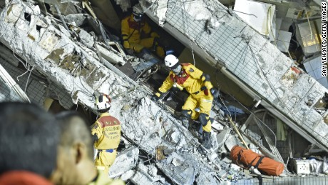 Rescue personnel work at the site of a collapsed building in Tainan.