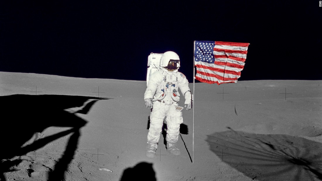 Mitchell stands by the U.S. flag during his mission's first spacewalk.