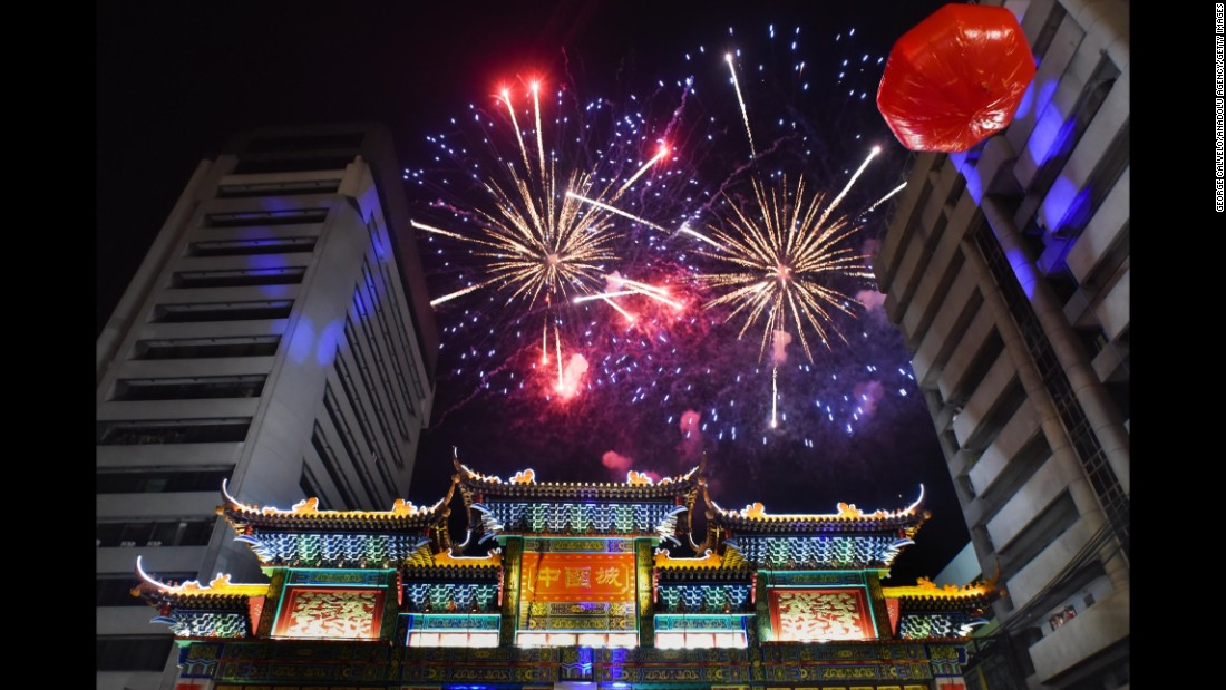 Fireworks celebrating the Lunar New Year illuminate the sky above the Chinatown friendship arch in Manila on Sunday, February 7.