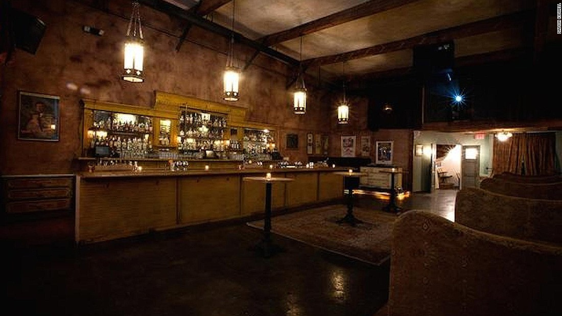 The bar's decor consists of vintage movie posters, projected films, a billiards room, exposed brickwork and stained glass.