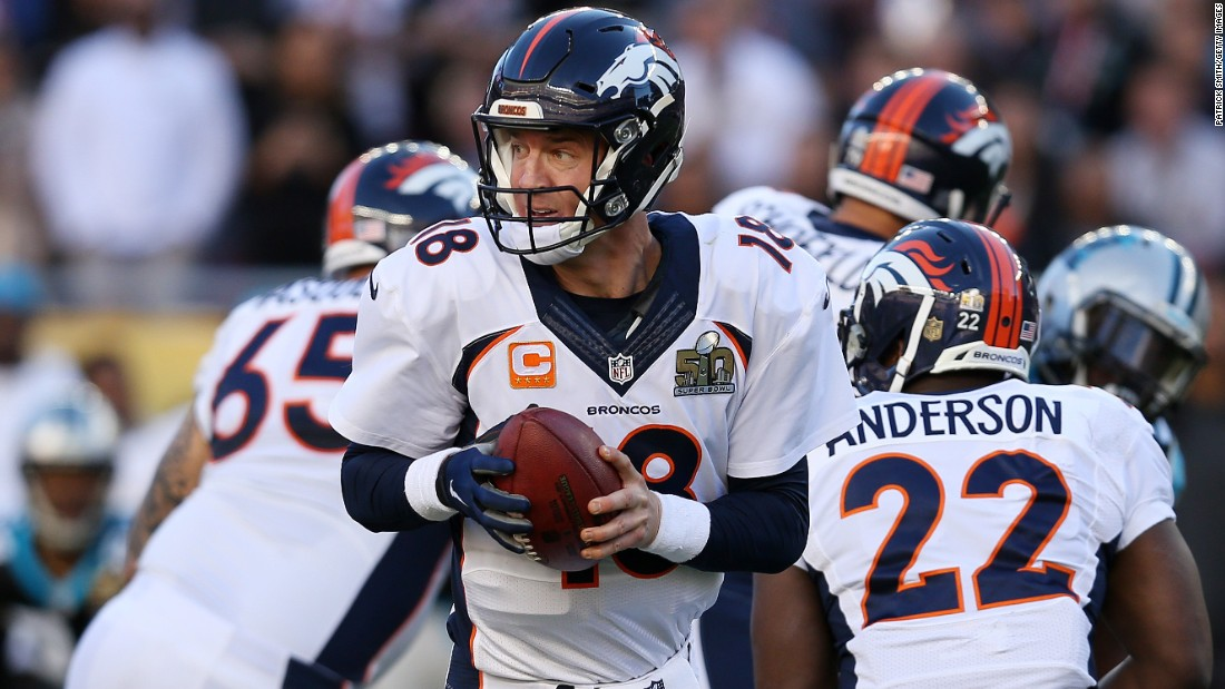Manning looks to hand the ball off in the first quarter.