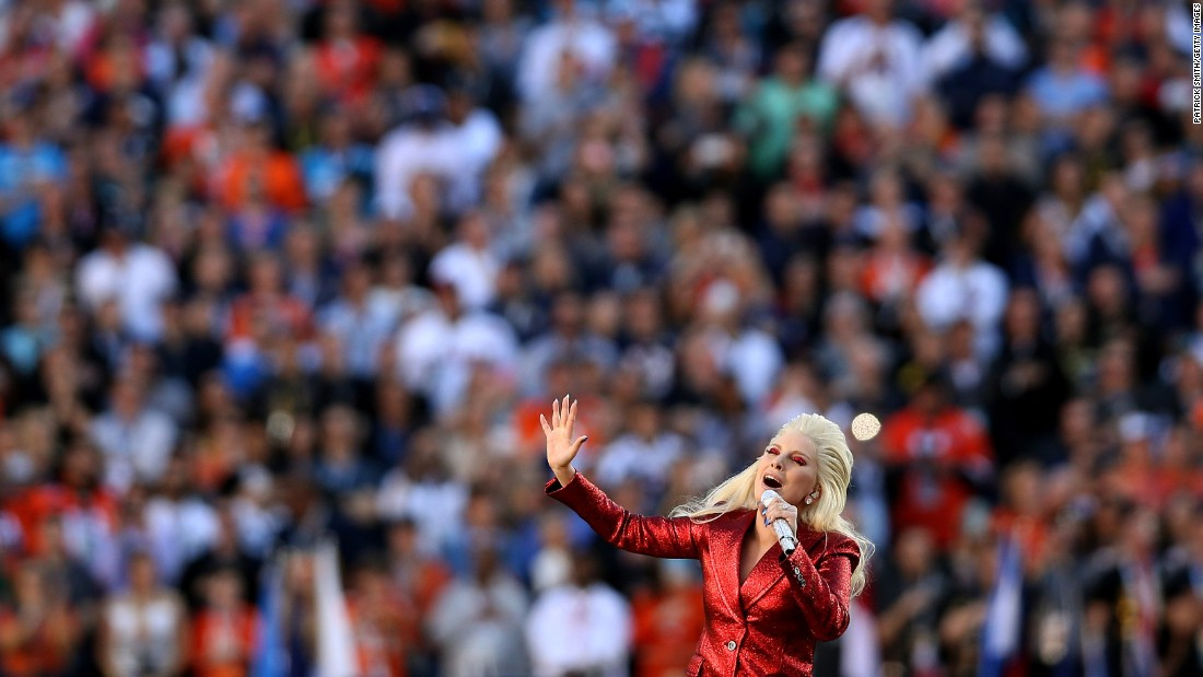 Lady Gaga performs the national anthem before the start of the game.