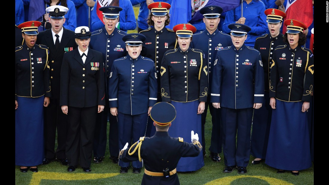 "Members of the U.S. military sing ""America the Beautiful."""