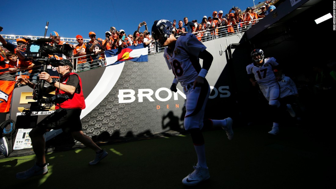 Manning and the Broncos take the field.