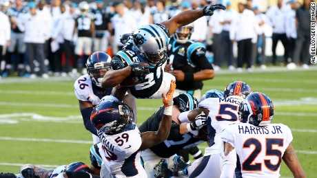 Carolina running back Jonathan Stewart leaps into the end zone for a touchdown in the second quarter.