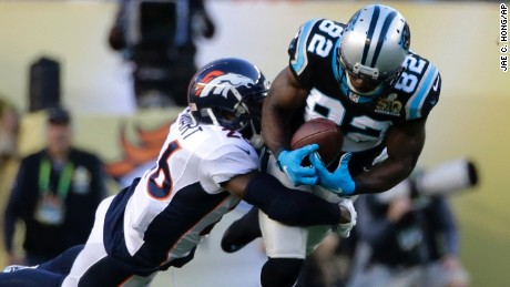 Jerricho Cotchery of the Panthers fails to catch a pass under pressure by the Broncos' Darian Stewart.
