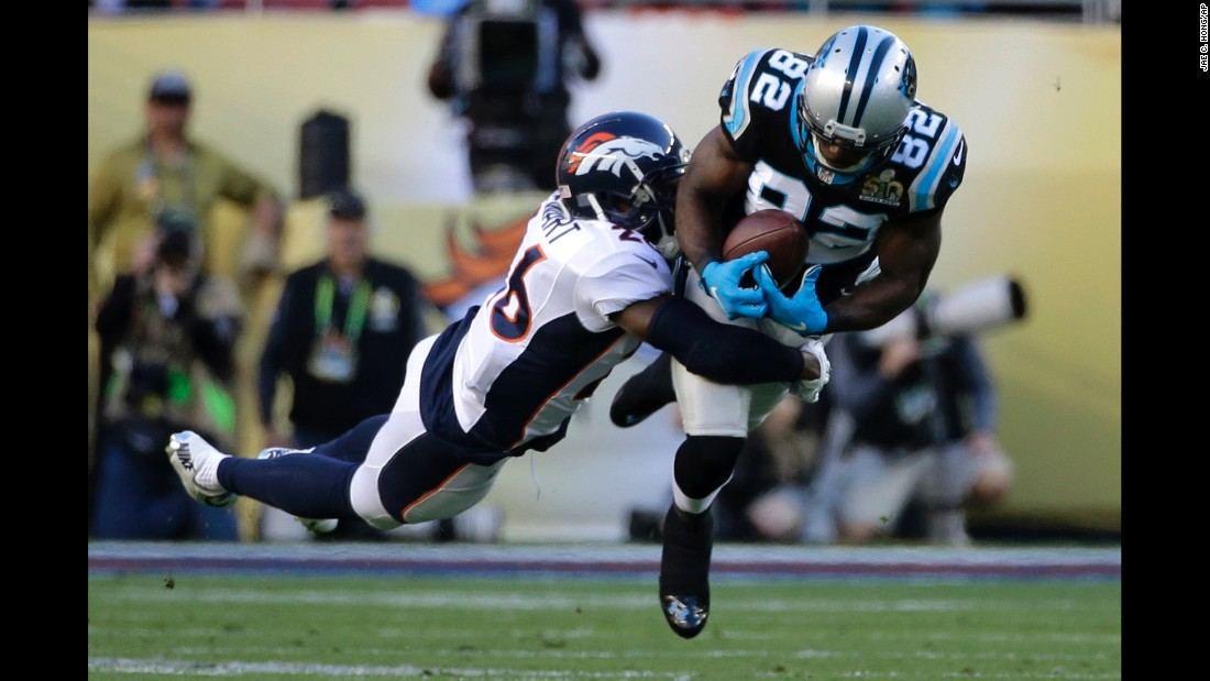 Carolina wide receiver Jerricho Cotchery tries to pull in a pass during the first quarter.