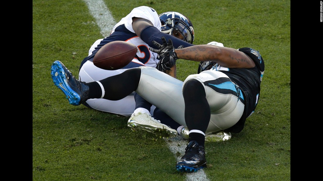 Tolbert fumbles in the first half as he is hit by the Broncos' Darian Stewart, left.