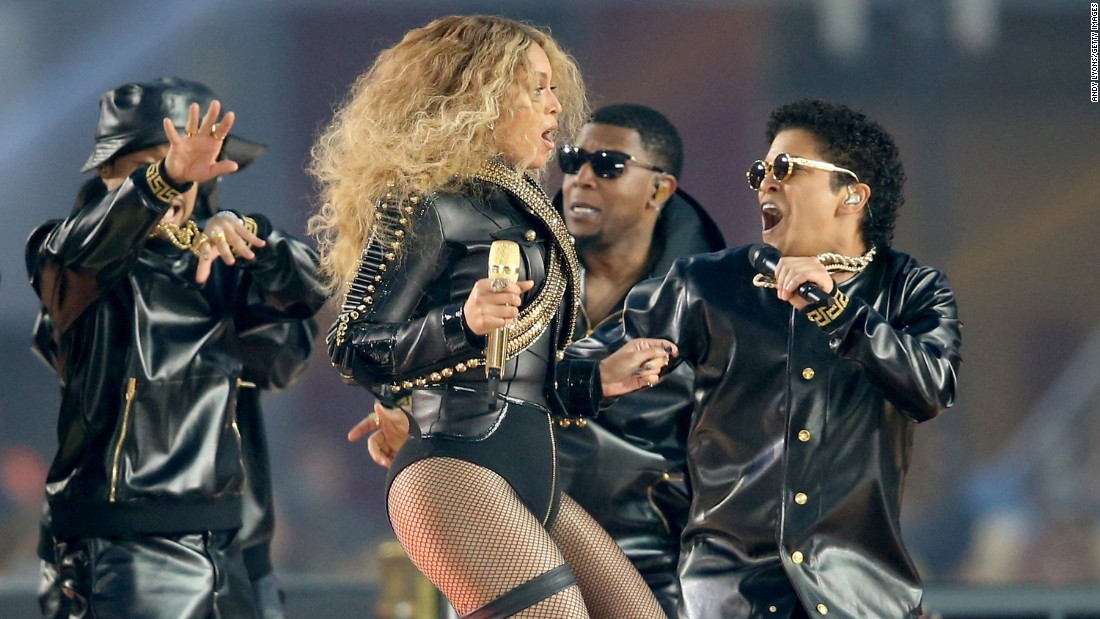 Beyonce takes the stage with Bruno Mars, right.