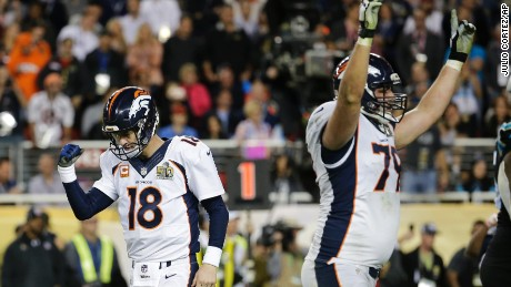 Denver Broncos Peyton Manning (18) and Michael Schofield (79) celebrate a touchdown against the Carolina Panthers during the second half of the NFL Super Bowl 50 football game Sunday, Feb. 7, 2016, in Santa Clara, Calif. (AP Photo/Julio Cortez)
