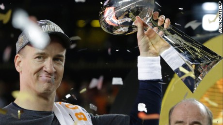 Denver Broncos Peyton Manning (18) holds up the trophy after the NFL Super Bowl 50 football game Sunday, Feb. 7, 2016, in Santa Clara, Calif. The Broncos beat the Panthers 24-10. (AP Photo/Julio Cortez)