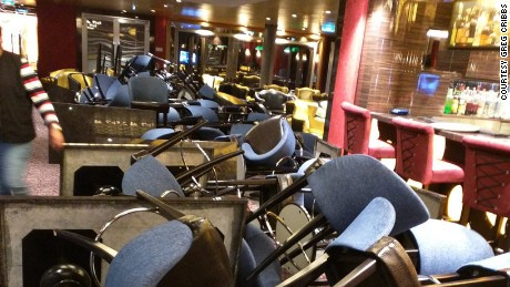 Rough seas on the cruise ship left tables and chairs flipped over.