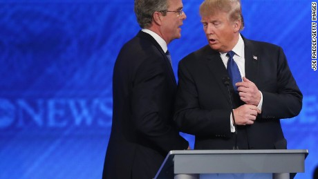 MANCHESTER, NH - FEBRUARY 06:  Republican presidential candidates Jeb Bush (L) and Donald Trump talk following the Republican presidential debate at St. Anselm College February 6, 2016 in Manchester, New Hampshire. Sponsored by ABC News and the Independent Journal Review, this is the final televised debate before voters go to the polls for the New Hampshire primary on February 9.  (Photo by Joe Raedle/Getty Images)