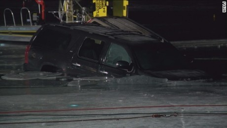 Cars plunge through ice at Winterfest