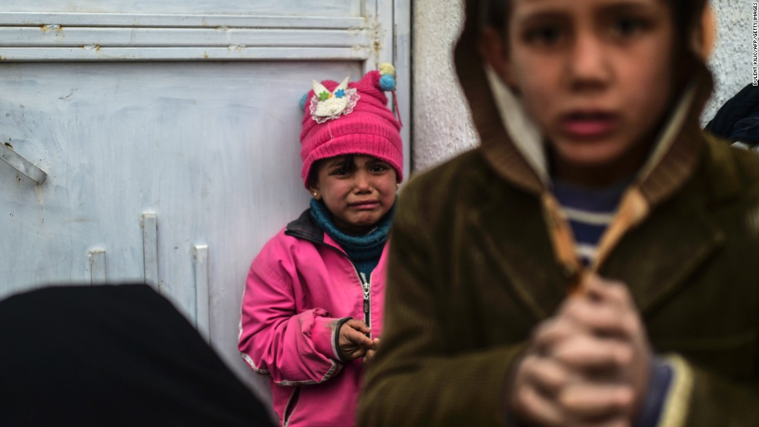 A refugee girl reacts near the Turkish border gate on February 6.