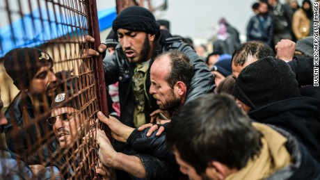 Refugees push each other as they wait for tents as Syrians fleeing the northern embattled city of Aleppo wait on February 6, 2016 in Bab al-Salama, near the city of Azaz, northern Syria, near the Turkish border crossing. Thousands of Syrians were braving cold and rain at the Turkish border Saturday after fleeing a Russian-backed regime offensive on Aleppo that threatens a fresh humanitarian disaster in the country's second city. Around 40,000 civilians have fled their homes over the regime offensive, according to the Syrian Observatory for Human Rights monitor. / AFP / BULENT KILIC        (Photo credit should read BULENT KILIC/AFP/Getty Images)