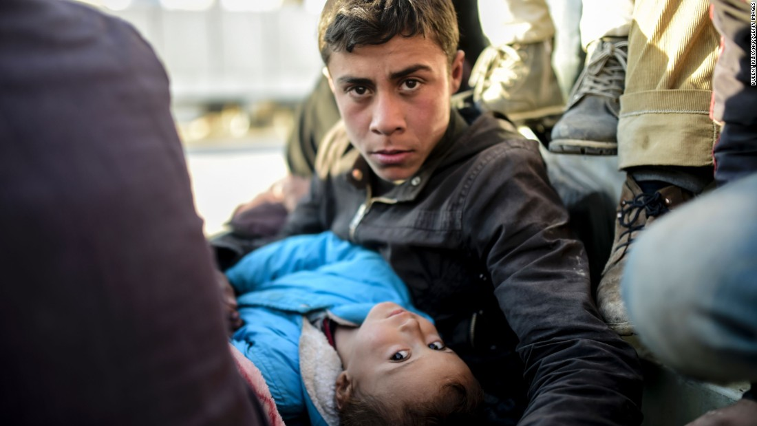 A Syrian teenager and a child look on near the Turkish border on February 5.
