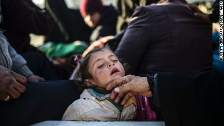 TOPSHOT - A child sleeps as Syrians fleeing the northern embattled city of Aleppo wait at the Bab al-Salama crossing on the border between Syria and Turkey, on February 5, 2016. Nearly 40,000 Syrian civilians have fled a regime offensive near Aleppo, a monitor said, as Turkey warned it was bracing for a wave of tens of thousands of refugees. / AFP / BULENT KILIC        (Photo credit should read BULENT KILIC/AFP/Getty Images)